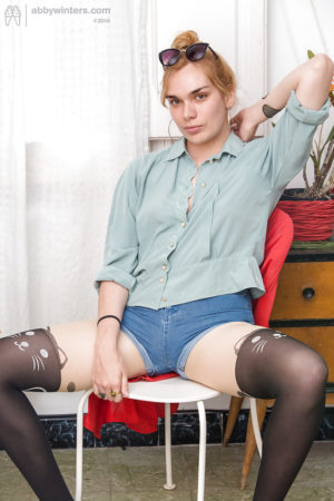 Wild haired blonde Layla K in pantyhose and stockings showing her hair pie