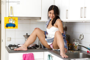 Petite Indian coed Diah wets her hairy pussy in the kitchen